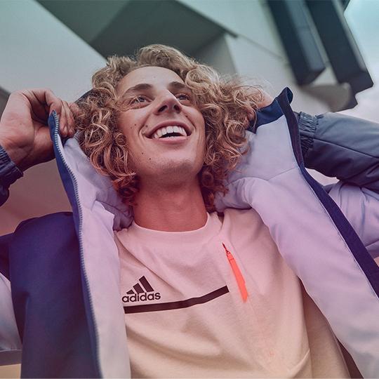 man_wearing_blue_adidas_coat_and_light_shirt_540x540_gradient
